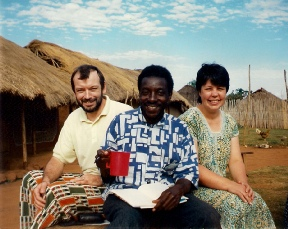 Pastor Paul Mutaasa enjoying a cup of tea with some visitors in 1997