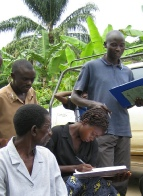 Lamech, the extension worker, trains buck-keepers in record keeping
