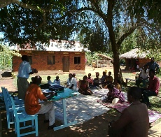 Training a farmers group in Masaka District